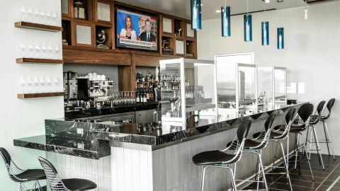 The bar will provide service directly to guests, but the chairs in this photo will be removed to promote social distancing.