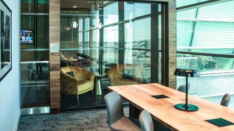 This area for business travelers is adjoined by a small private room that can accomodate a pair of travelers who want privacy.
