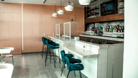 Lounge guests can order drinks from the lower level bar, but the bar seats in this photo will be temporarily removed.