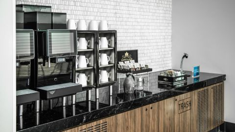 A self-service coffee area on the upper floor will be open when the lounge opens.