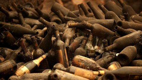 """Burned bottles of wine sit in a pile at the Castello di Amorosa winery, which was destroyed by the Glass Fire in Calistoga, California, on October 1. Wildfires have damaged and <a href=""""https://www.cnn.com/2020/10/11/us/california-wildfires-wineries/index.html"""" target=""""_blank"""">destroyed dozens of the region's famed wineries,</a> many of them family-owned businesses."""