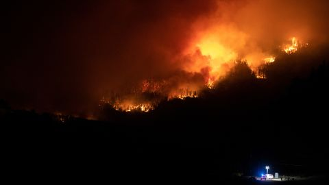 Flames from the Cameron Peak Fire, the largest wildfire in Colorado history, work their way along a ridge outside Estes Park on October 16.