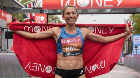 Hall celebrates her performance at the London Marathon finish line.