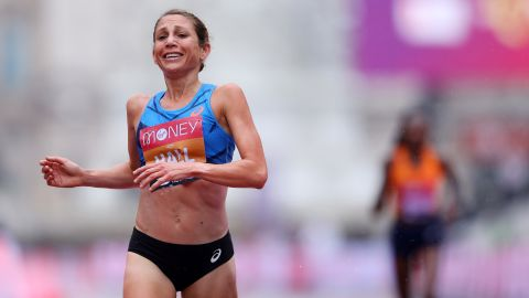 Hall crosses the finish line in second place at the London Marathon.