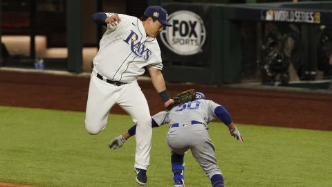 The Dodgers beat the Rays 6-2 in Game 3 on Friday, October 23, taking a 2-1 series lead. Here, Rays' first baseman Ji-Man Choi tags out Mookie Betts at first base during the eighth inning.