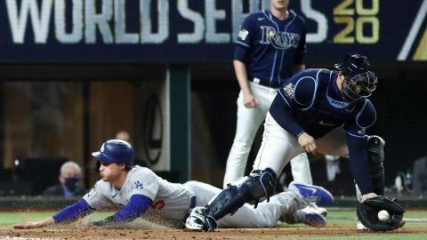 The Dodgers' Corey Seager slides into home plate safely with a run against the Rays during the fifth inning.