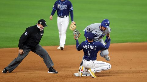 The Dodgers' Max Muncy is tagged out at second base by the Rays' Willy Adames during the fifth inning.