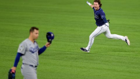 The Rays' Brett Phillips celebrates after hitting a two-run walk-off single to beat the Dodgers 8-7 in Game 4 at Globe Life Field in Arlington, Texas, on Saturday, October 24.