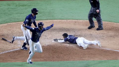 The Rays' Randy Arozarena slides into home plate during the ninth inning to score the winning run in Game 4.