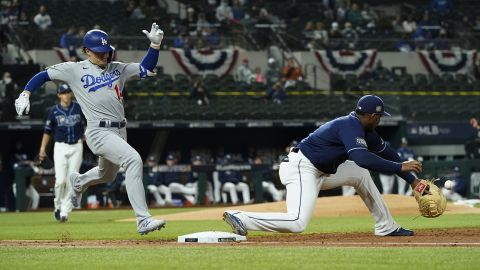 The Dodgers' Enrique Hernandez is forced out at first by the Rays' first baseman Yandy Diaz during the third inning.