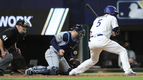 Rays' Mike Zunino chases a wild pitch by Nick Anderson in the sixth inning.