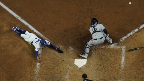 Los Angeles Dodgers' Mookie Betts scores past Tampa Bay Rays catcher Mike Zunino during the sixth inning.