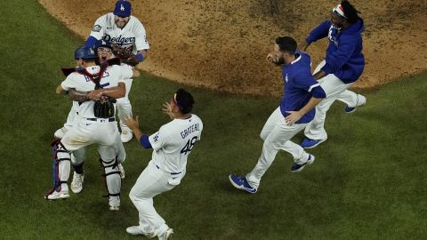 Los Angeles Dodgers celebrate after defeating the Tampa Bay Rays 3-1 to win the baseball World Series in Game 6 on Tuesday, October 27, in Arlington, Texas.