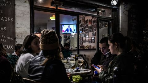 Clients sit at a cafe in Bordeaux, southern France, on October 28, 2020, during French President Emmanuel Macron's announcement of new measures aimed at curbing the spread of the Covid-19 pandemic.