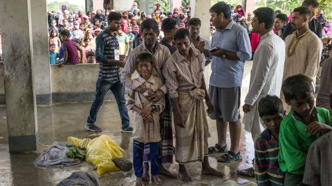 """Rohingya refugees mourn beside the bodies of relatives who died <a href=""""http://www.cnn.com/2017/09/29/asia/rohingya-refugee-boat-capsize/index.html"""">when a boat capsized</a> in late September."""