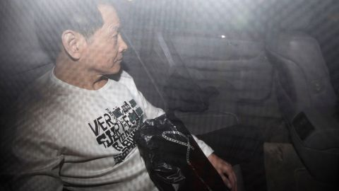 Former triad leader Wan Kuok-koi, alias Broken Tooth, leaves in a car after his release from prison in Macau on December 1, 2012.