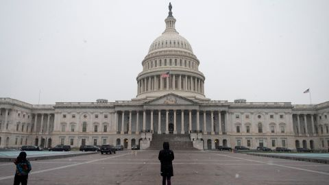 People walk past the US Capitol in Washington, DC on December 16, 2020.