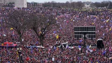 People rally near the White House in support of Trump.