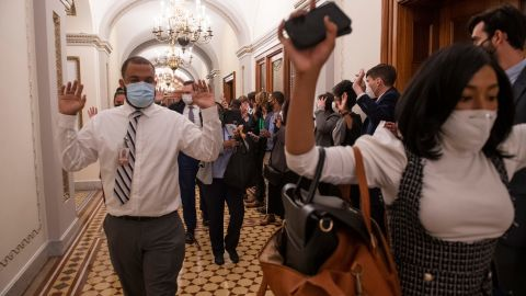 Congressional staffers evacuate the Capitol.