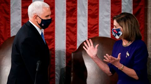 """Pence and House Speaker Nancy Pelosi officiate a joint session of Congress in January 2021. Congress was meeting to count and certify Electoral College votes before <a href=""""http://www.cnn.com/2021/01/06/politics/gallery/electoral-college-vote-count/index.html"""" target=""""_blank"""">the US Capitol was breached by pro-Trump rioters.</a>"""