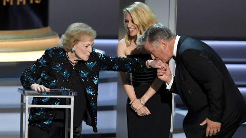 Alec Baldwin kisses White's hand at the Emmy Awards in 2018.