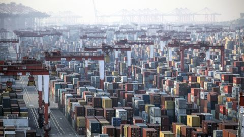 Shipping containers next to gantry cranes at the Yangshan Deepwater Port in Shanghai, China, on Monday, Jan, 11, 2021.