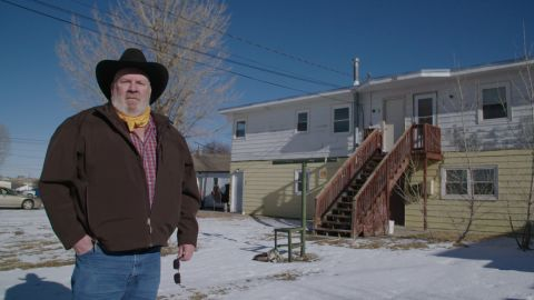 """Steve Gray stands outside his home in Gillette, Wyoming. He called CNN concerned that, following the election of President Biden, that Gillette could become a """"ghost town."""" He says he was laid off from an oil field job in 2015, then subsequently from another job in oil and then one in coal last year."""