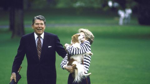 Ronald Reagan and first lady Nancy Reagan are joined by their dog Rex after visiting Camp David. Rex was a Cavalier King Charles Spaniel.