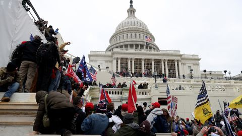 WASHINGTON, DC - JANUARY 06: Protesters gather outside the U.S. Capitol Building on January 06, 2021 in Washington, DC. Pro-Trump protesters entered the U.S. Capitol building after mass demonstrations in the nation's capital during a joint session Congress to ratify President-elect Joe Biden's 306-232 Electoral College win over President Donald Trump.  (Photo by Tasos Katopodis/Getty Images)