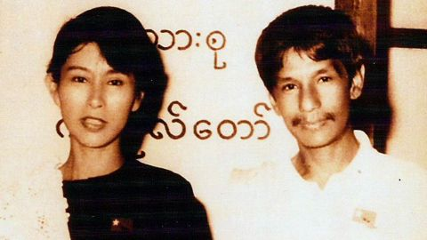 """Suu Kyi poses with Burmese comedian Par Par Lay, who was part of the pro-democracy act """"The Moustache Brothers."""" Suu Kyi grew up in Myanmar and India but moved to England in the 1960s, where she studied at Oxford University. She returned to Myanmar in 1988 and co-founded the National League for Democracy, a political party dedicated to nonviolence and civil disobedience."""