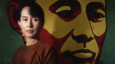 Suu Kyi poses in front of a portrait of her father in 1999. In 2000, she was once again placed under house arrest.