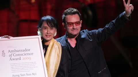 Suu Kyi accepts the Ambassador of Conscience Award next to U2 singer Bono during a European tour in 2012.