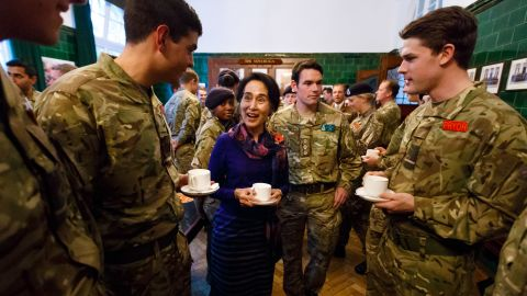 Suu Kyi joins officer cadets for tea while visiting a military academy in Camberley, England, in 2013.