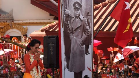 Suu Kyi descends from a stage decorated with a portrait of her late father during a campaign rally in 2015.