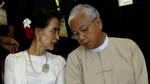 Suu Kyi and President Kyaw talk at a conference in Naypyidaw in 2016.