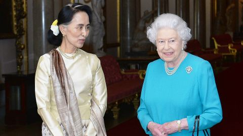Britain's Queen Elizabeth II greets Suu Kyi ahead of a private lunch at Buckingham Palace in 2017.