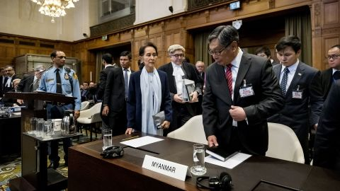 """Suu Kyi stands before the UN's International Court of Justice in 2019. The nation of Gambia filed a lawsuit in the world court <a href=""""https://www.cnn.com/2019/12/13/asia/rohingya-suu-kyi-myanmar-hague-intl-hnk/index.html"""" target=""""_blank"""">alleging that Myanmar committed """"genocidal acts""""</a> against Myanmar's Rohingya Muslims. Suu Kyi has repeatedly denied such charges, siding with the military and labeling the accusations as """"misinformation."""""""