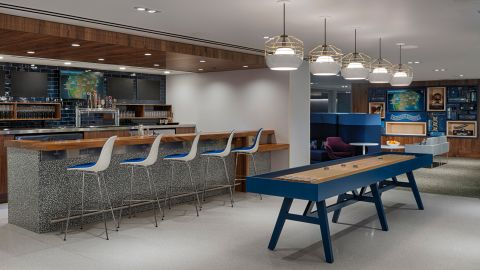 The Denver Centurion Lounge has games and a craft beer bar with local brews.