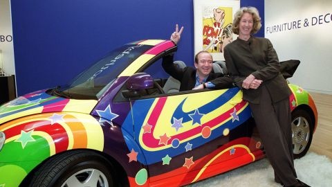 """Bezos and Sotheby's president and CEO Diana Brooks pose in a customized Volkswagen Beetle from the film """"Austin Powers: The Spy Who Shagged Me"""" in 1999. Sotheby's and Amazon had teamed up to launch sothebys.amazon.com, an online auction site that would offer a broad range of objects, including this car."""