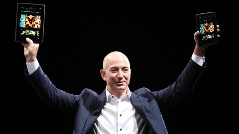 Bezos holds up the new Kindle Fire HD during a news conference in Santa Monica, California, in 2012.