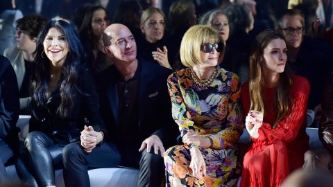 Bezos sits between his girlfriend, Lauren Sánchez, and Vogue magazine editor Anna Wintour at a Tom Ford fashion show in Los Angeles in February 2020.