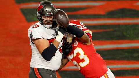 Kansas City linebacker Anthony Hitchens punches the ball away from Tampa Bay's Joe Haeg just prior to the Chiefs' stop on 4th-and-goal.