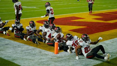 Tampa Bay players celebrate together after Winfield Jr. intercepted a Mahomes pass in the second half.