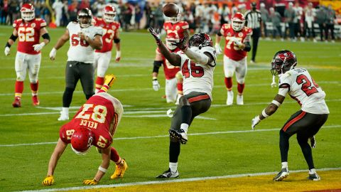Tampa Bay linebacker Devin White intercepts a pass late in the game.