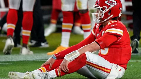 Mahomes sits on the turf during the second half. It was a rough game for last year's Super Bowl MVP, who was under heavy pressure all night.