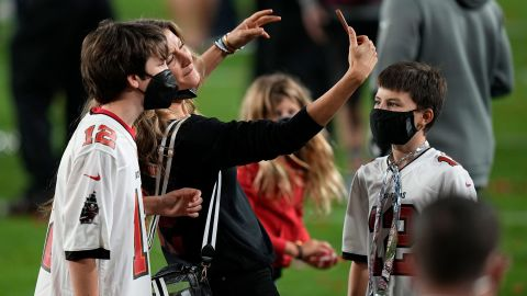 Brady's children are seen on the field as his wife, supermodel Gisele Bundchen, takes a selfie during the postgame celebrations.