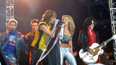 Spears performs with Aerosmith frontman Steven Tyler as part of the Super Bowl halftime show in 2001.