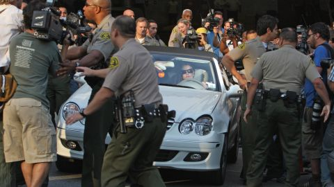 Spears leaves a Los Angeles courthouse after a child custody hearing in 2007. A few months later, she was hospitalized over issues involving the custody of her children. Federline, her ex-husband, was awarded sole custody. In February 2008, a Los Angeles court granted temporary conservatorship to Spears' father, Jamie, after Britney was taken to a hospital and deemed unable to take care of herself.