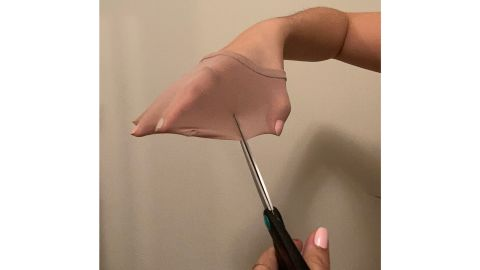 Attempting to cut the Sheertex tights with scissors