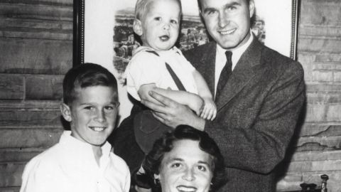 Bush, left, is the eldest child of George and Barbara Bush. Barbara is holding her youngest son, Marvin, and her husband is holding their son Neil. At bottom left is their son Jeb. The couple also had a young daughter, Robin, who died from leukemia in 1953.